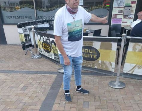 56-year-old Dave Hodgkinson demonstrating his foot-up leg strings outside Soul Suite bar in Blackpool that help him walk after being diagnosed with Motor Neurone Disease