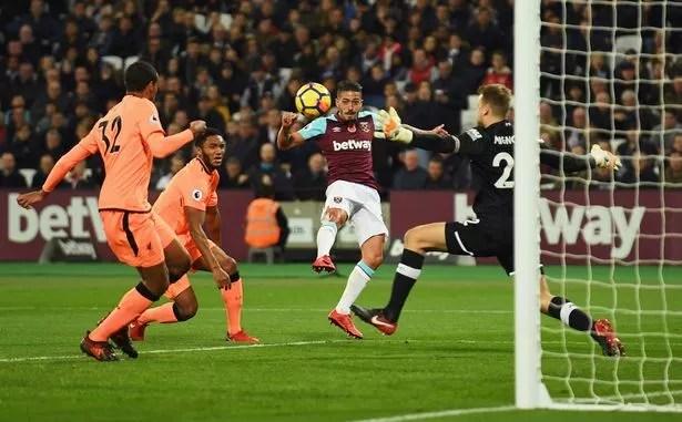 Manuel Lanzini of West Ham United scores against Liverpool