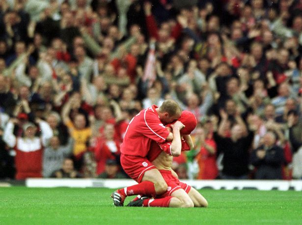 Danny Murphy Helps John Arne Riise Celebrate His Goal During The Fa Barclaycard Premiership Game Between