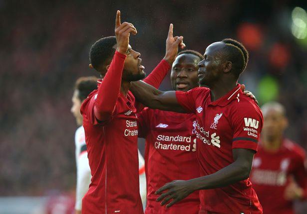 Georginio Wijnaldum celebrates after scoring his team's second goal with teammates Sadio Mane and Naby Keita during the Premier League match between Liverpool FC and AFC Bournemouth at Anfield on February 9, 2019