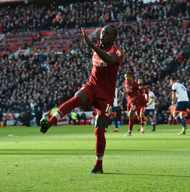 Sadio Mane scores the opening goal and celebrates during the Premier League match between Liverpool FC and AFC Bournemouth at Anfield on February 9, 2019