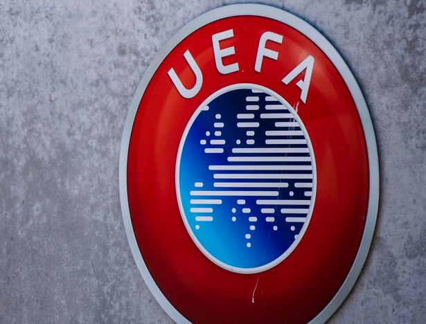 The UEFA logo displayed at the entrance to the headquarters in Nyon