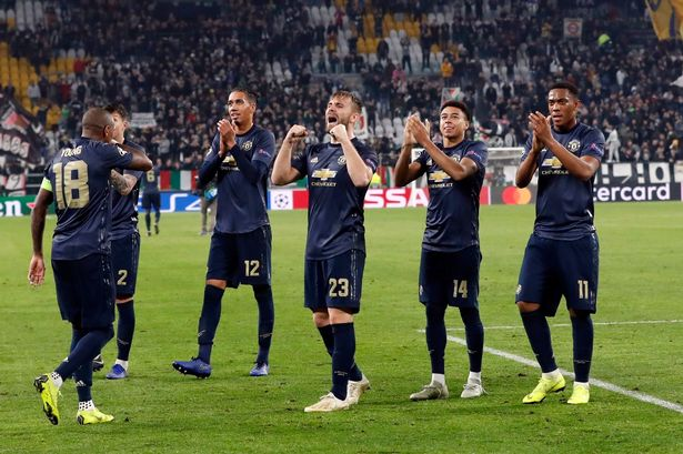 United players applaud the fans at full-time