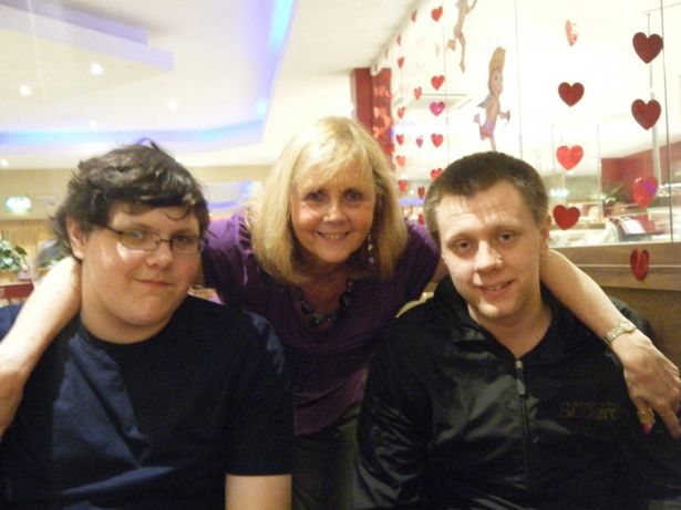 Linda with her two sons, James, 23, left, and Rob, 28, right