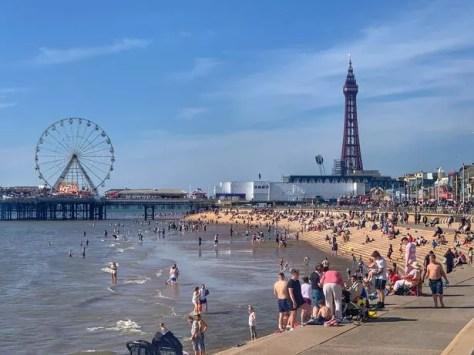 People enjoy the sunshine at Blackpool beach,