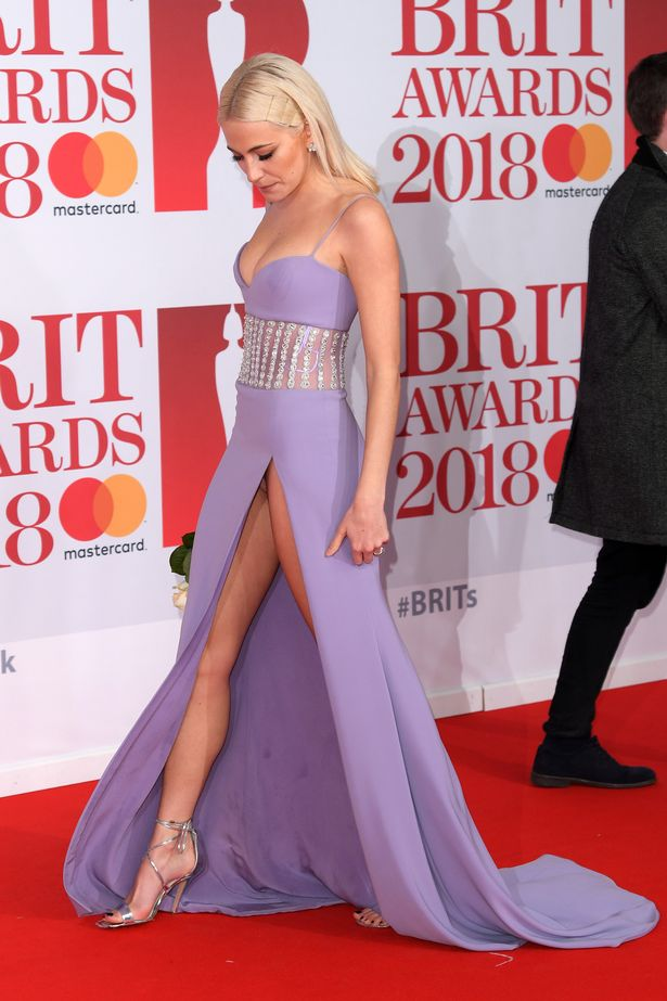Pixie Lott suffers embarrassing wardrobe malfunction and flashes her knickers on the red carpet at the Brit Awards