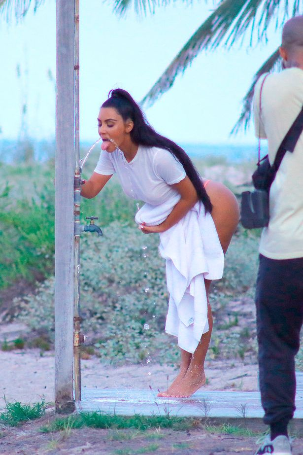 Kim Kardashian comes awkwardly close to flashing too much in impossibly-tiny thong