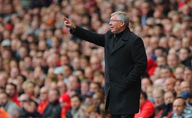 Sir Alex Ferguson gestures during a game against Liverpool in 2012