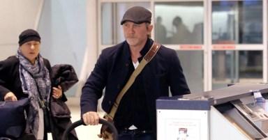 Hands-on dad Daniel Craig looks exhausted as he cradles newborn daughter