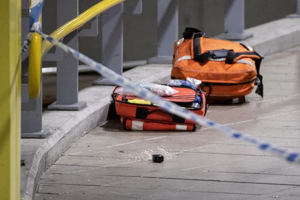A discharged Taser and paramedic equipment can be seen lying on Metrolink platform B after the incident