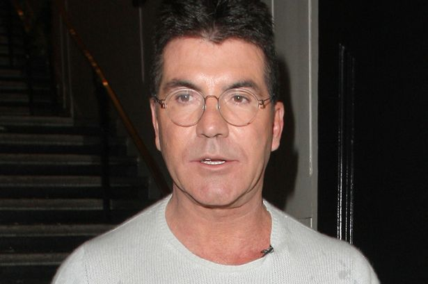 Simons Got Specs Appeal Cowell Shows Off New Round