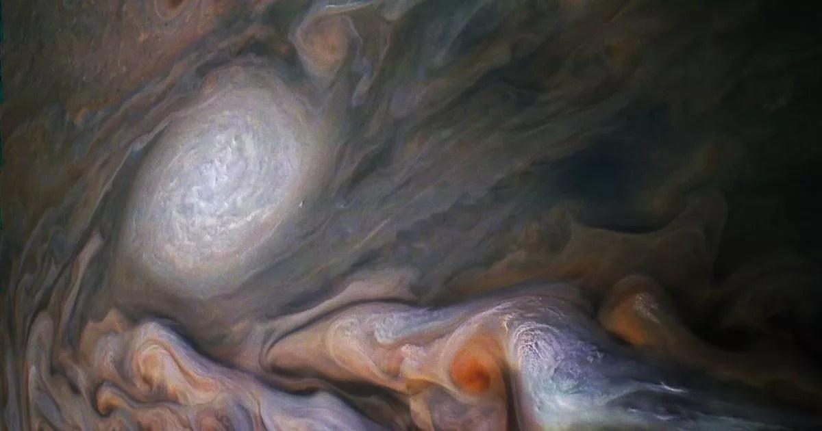NASA's Juno spacecraft takes stunning storm photos swirling over Jupiter