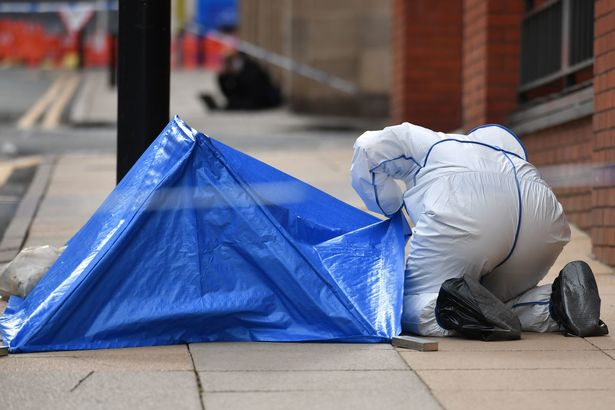 A police forensic tent was erected on the street