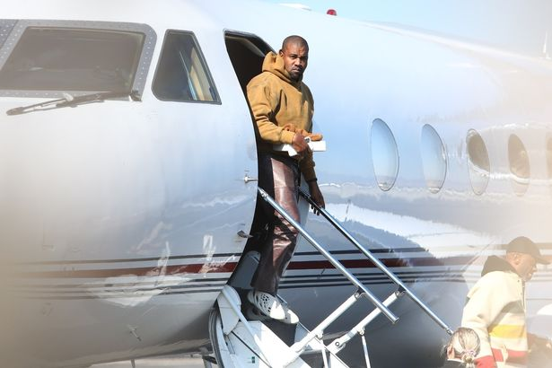 Kanye West did not stay away from the cameras when he landed at Van Nuys Airport.