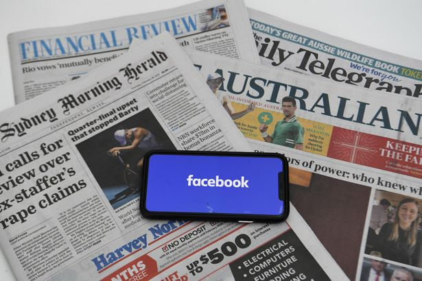 An illustration image shows a phone screen with the 'Facebook' logo and Australian Newspapers at Parliament House in Canberra, Thursday, February 18