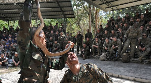 A US marine is fed the blood of a cobra