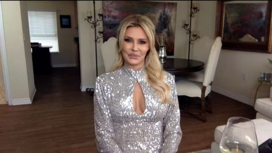 Brandi Glanville talks to Andy Cohen from his house