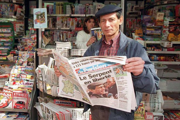 Charles Sobhraj, pictured in Paris in 1997, brazenly reading a newspaper about himself