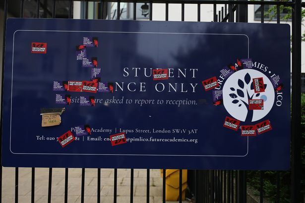 Anti-fascism and anti-racism stickers on a sign outside Pimlico Academy