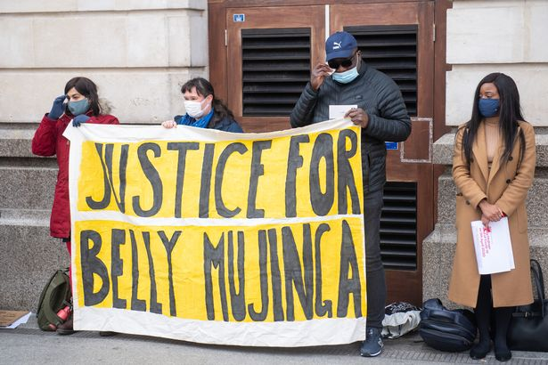 Lusamba Katalay, the husband of Belly Mujinga joins activists at a vigil at Victoria station
