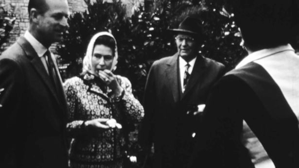 A young queen eating an orange with President Tito during her visit to Belgrade in 1972