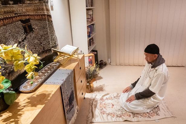 Father of three Afrizal of the Abbas family leads Taraweeh prayers with his family on May 22, 2020 in Melbourne,