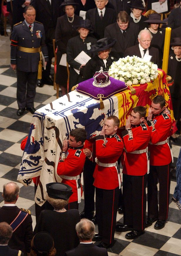 The coffin of Queen Elizabeth the Queen Mother is carried out of Westminster Abbey.