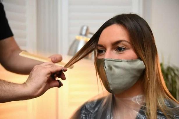 Secret Spa hair stylist Nas Ganev cuts the hair of Amy Pallister, 27
