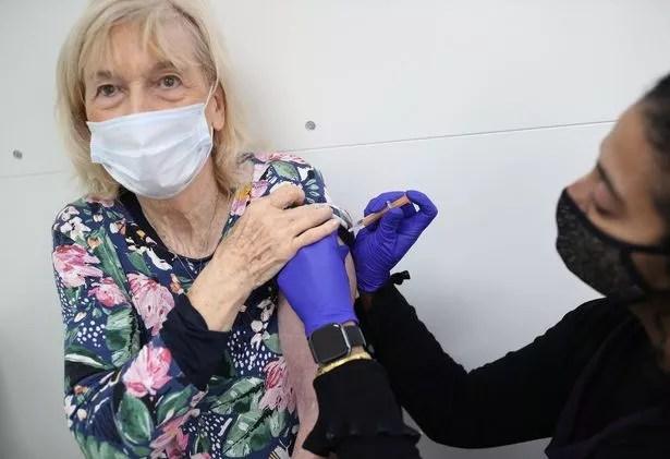 Pharmacist Asha Fowells vaccinates Catherine Jinadu, aged 82