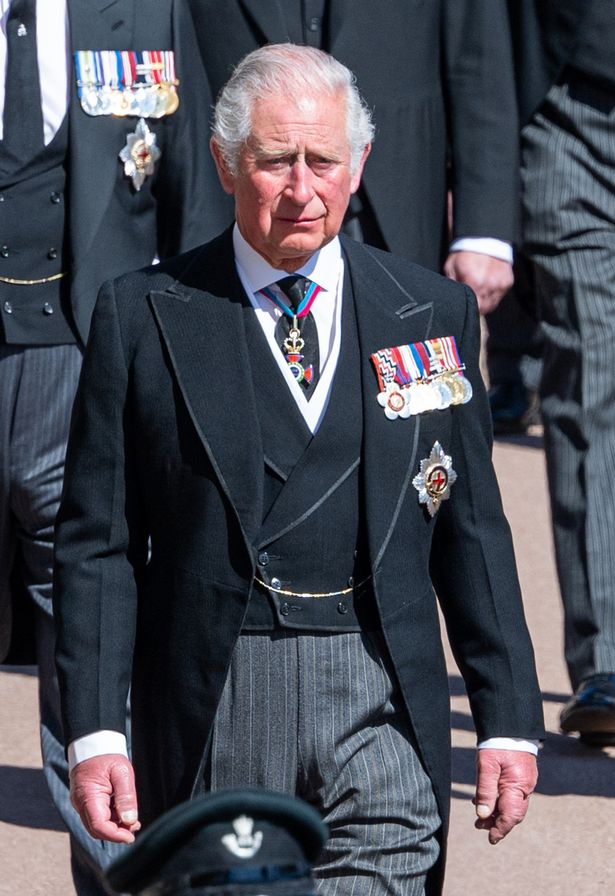 Prince Charles walks behind his father Prince Philip's coffin at Saturday's funeral