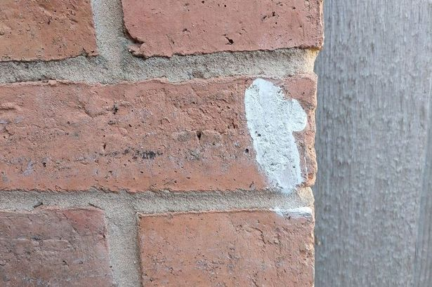 The markings appeared on homes following a visit from a fake salesman