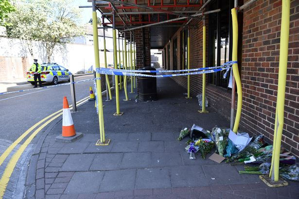 Flowers and tributes left at the scene of the alleged murder in Walton on Thames
