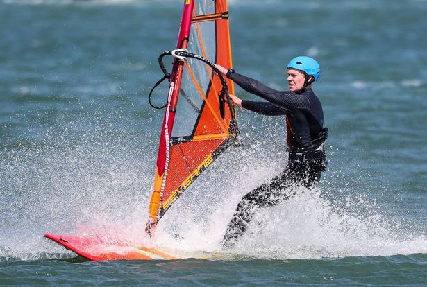 A windsurfer at Calshot beach in New Forest, Hampshire