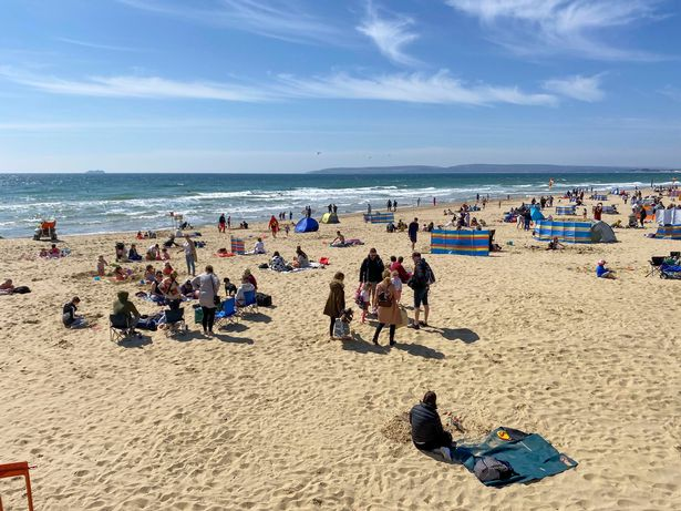 People on Bournemouth beach in Dorset today
