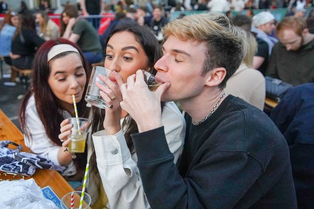 Revellers packed into beer gardens in Manchester city centre yesterday