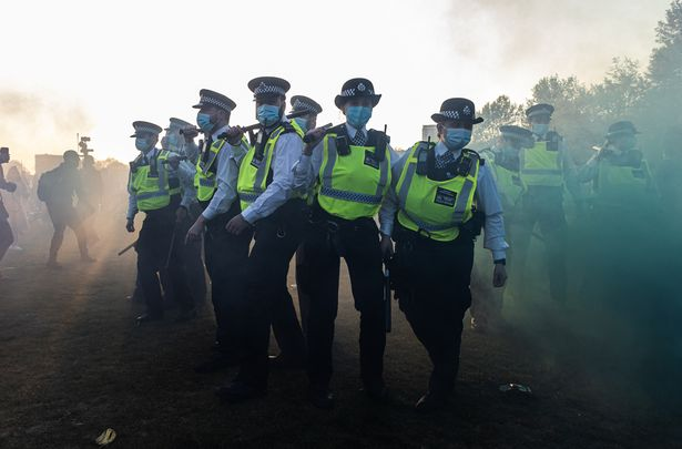 Officers were surrounded by crowds of protesters