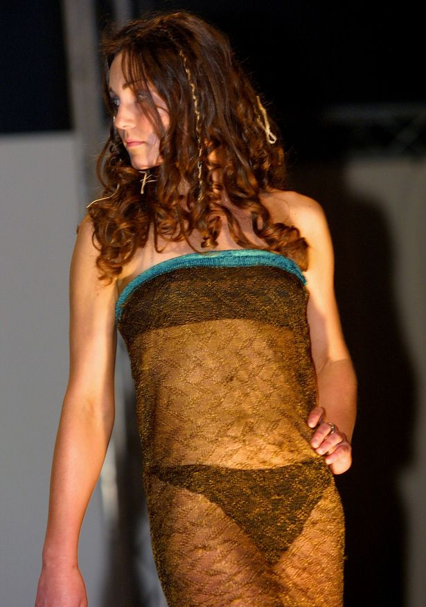 Kate Middleton models on the catwalk at a student fashion show attended by Prince William, on March, 26, 2002 in St.Andrews, Scotland. Clarence House today announced Prince William and Kate Middleton are engaged to be married. The pair became engaged last month on a trip to Kenya. It is reported that this is the event that Kate first caught William's eye after paying £200 to watch fellow students model on the runway.