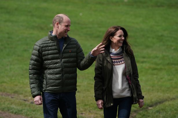 The Duke and Duchess of Cambridge walk together during their visit to Manor Farm in Little Stainton