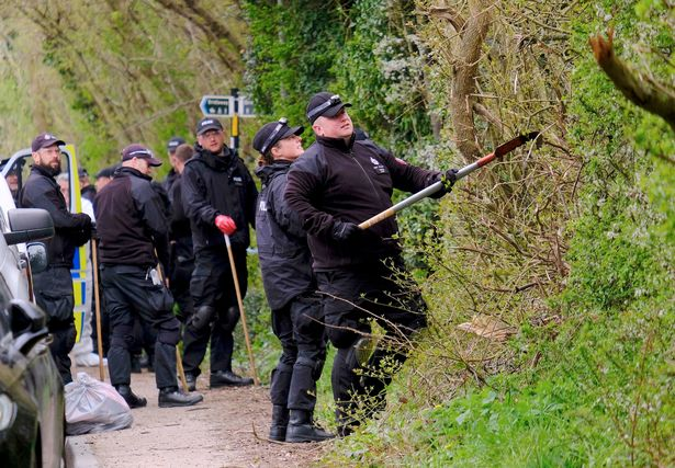 Police at the scene where Julia James' body was discovered on Tuesday