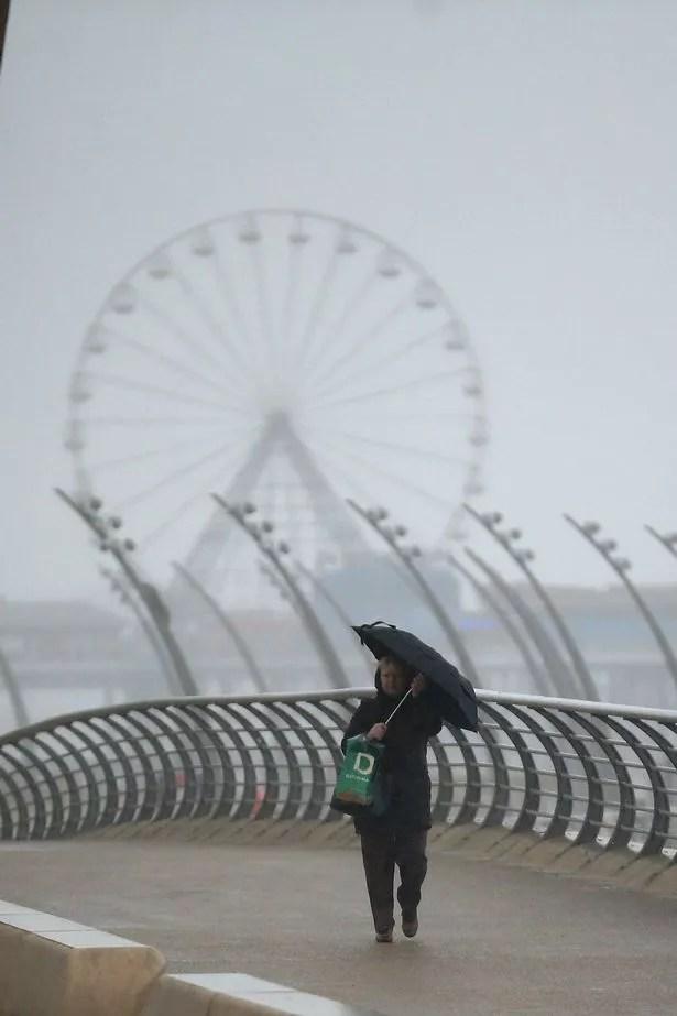 Visitors brave high winds and rain on Blackpool promenade