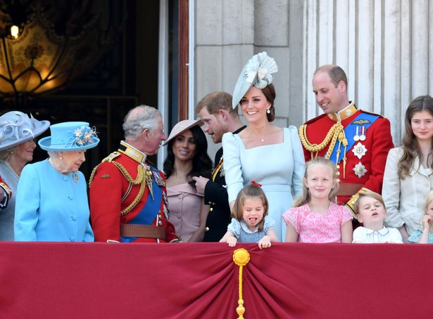 Queen Elizabeth II, Prince Charles, Prince of Wales, Meghan, Duchess of Sussex, Prince Harry, Duke of Sussex, Catherine, Duchess of Cambridge, Prince William, Duke of Cambridge, Princess Charlotte of Cambridge, Savannah Phillips and Prince George of Cambridge on the balcony of Buckingham Palace during Trooping The Colour 2018