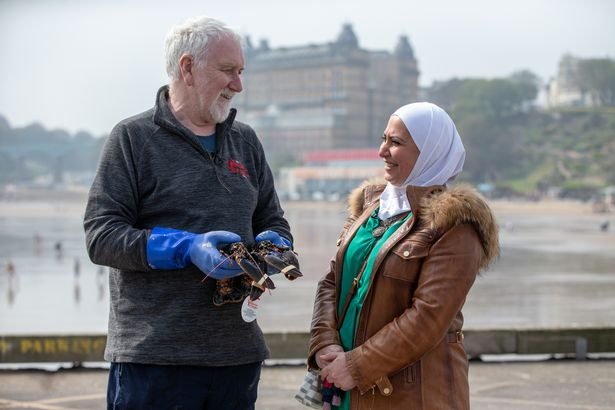 Bob and Razan chat on the harbour in Scarborough