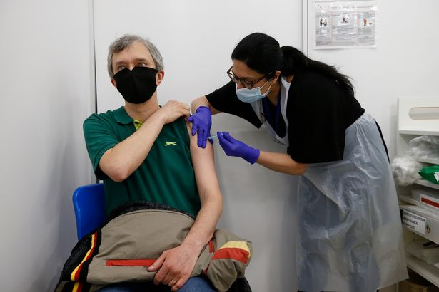Fabian Cassar, 47, receives an AstraZeneca vaccination at a Boots pharmacy on Fleet Street in the City of London