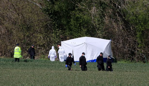 Police forensic officers near the scene at Akholt Wood