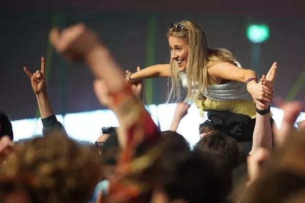 A concert-goer enjoys a non-socially distanced outdoor live music event at Sefton Park