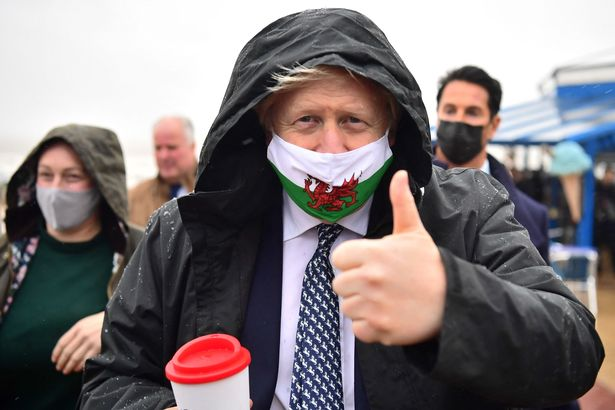 Boris Johnson said social distancing measures could be axed next month