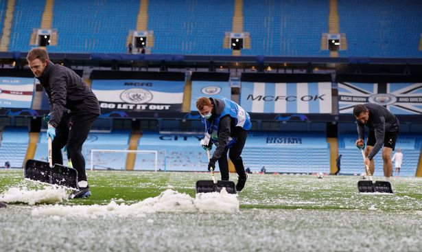 The football pitch had to be cleared before the match