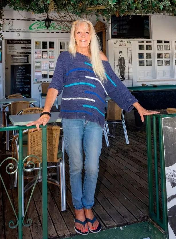Charlies bar owner Cathy Jump prays