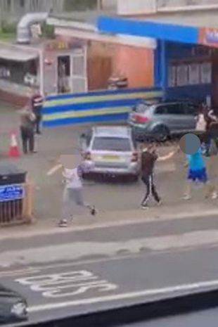 Video recorded by an eye witness shows a mass brawl break out