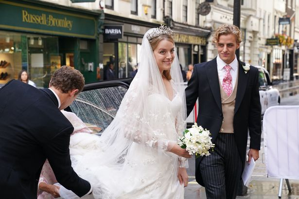 Flora wore a stunning white sweetheart neckline wedding gown, designed by Phillipa Lepley